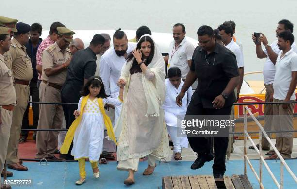 Bollywood actress Aishwarya Rai Bachchan walks next to her daughter Aaradhya Bachchan after immersing the ashes of her father Krishnaraj Rai in the...