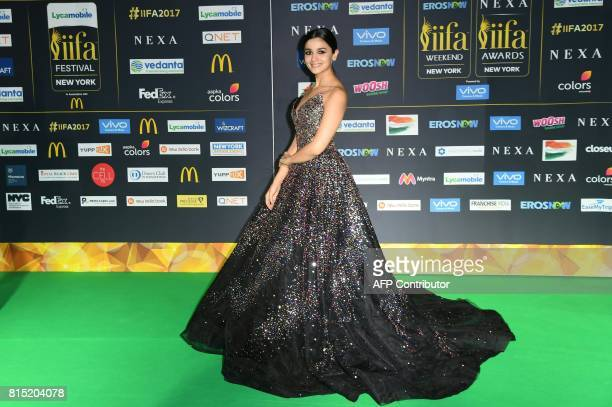 Bollywood actress Alia Bhat poses as she arrives for the IIFA Awards July 15 2017 at the MetLife Stadium in East Rutherford New Jersey during the...