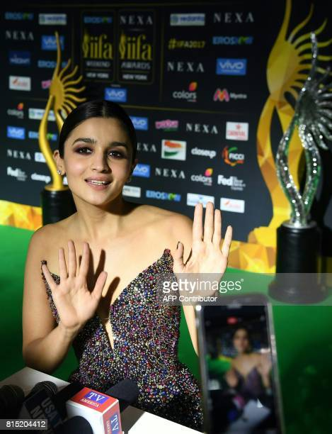Bollywood actress Alia Bhat poses for the media and answers questions as she arrives for the IIFA Awards July 15 2017 at the MetLife Stadium in East...