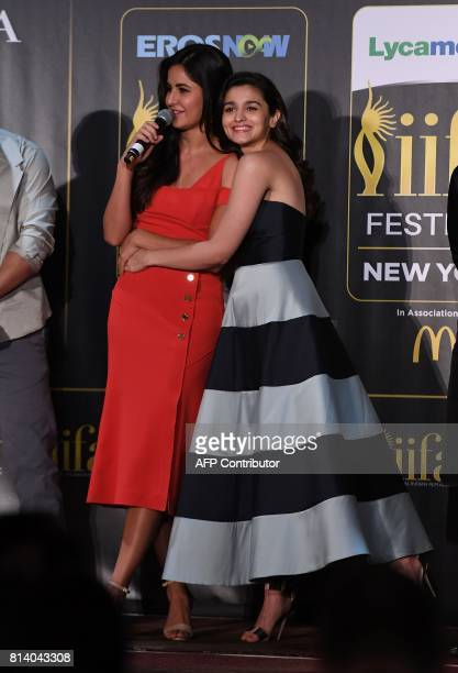 Bollywood actress Alia Bhatt hugs Katrina Kaif as she speaks during a press conference ahead of the 18th International Indian Film Academy Festival...