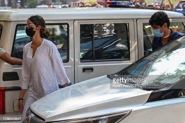 Bollywood actress Ananya Panday arrives along with her father actor Chunky Pandey at the Narcotics Control Bureau office in Mumbai on October 22,...