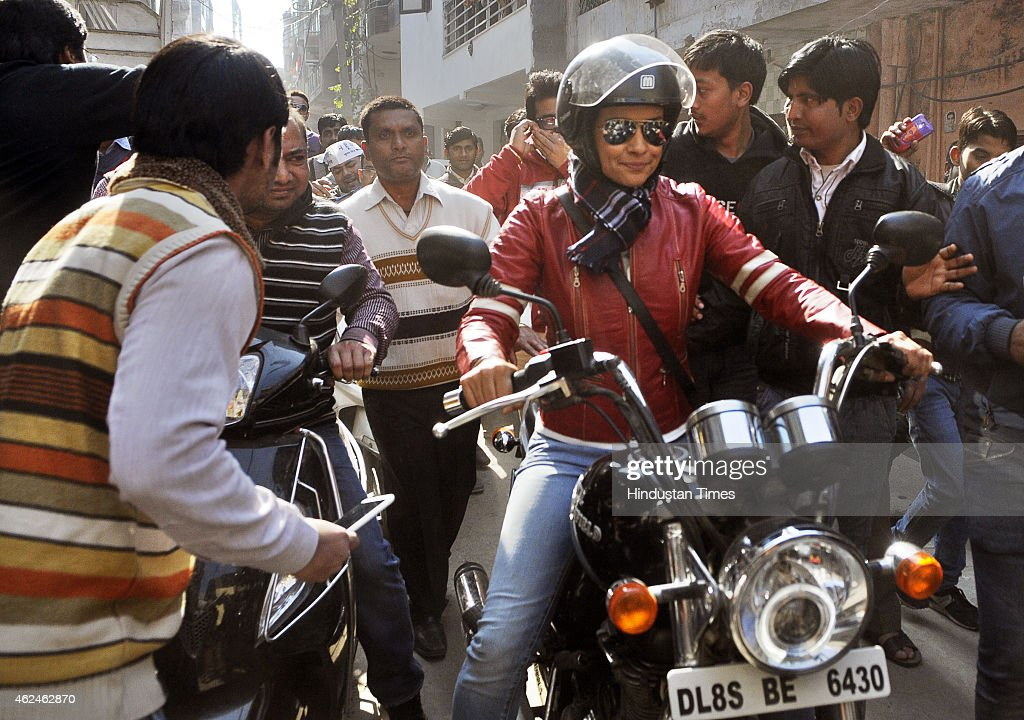 Bollywood actress and AAP leader Gul Panag rides bike during election campaign for the party candidate at Shashtri Nagar area for the upcoming Delhi Assembly elections 2015 on January 29, 2015 in New Delhi, India. Polling in Delhi will be held on February 7 and the counting of votes will take place on February 10.