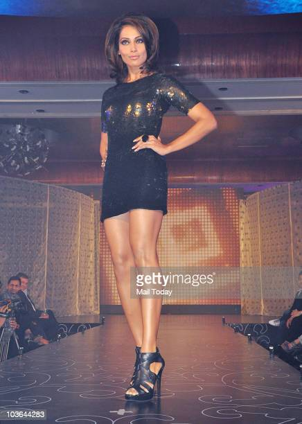 Bollywood actress and Dicitex Furnishing brand ambassador Bipasha Basu walks the ramp at a promotional event in Mumbai on August 25 2010