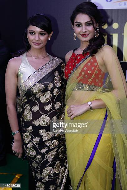 Bollywood actress Andrea Jeremiah and Pooja Kumar poses at the IIFA green carpet event at the 2012 International India Film Academy Awards at the...