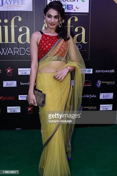 Bollywood actress Andrea Jeremiah poses at the IIFA green carpet event at the 2012 International India Film Academy Awards at the Singapore Indoor...