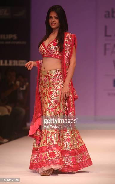 Bollywood actress Anjana Sukhani walks the ramp for designer Abhi Rahi on the fifth day of the Lakme Fashion Week in Mumbai on September 21 2010