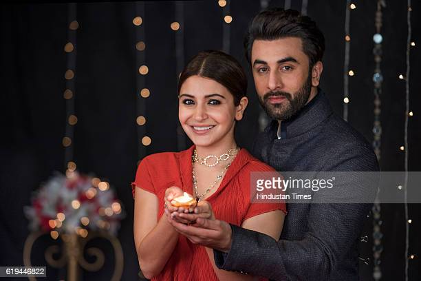 Bollywood actress Anushka Sharma and actor Ranbir Kapoor pose for the Diwali photo shoot on October 25 2016 in Mumbai India