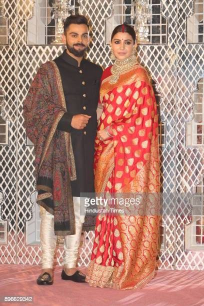 Bollywood actress Anushka Sharma and Indian Cricket captain Virat Kohli pose for photographers during their reception at the Durbar Hall Taj...