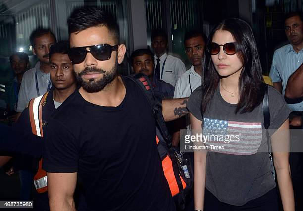 Bollywood actress Anushka Sharma and Indian cricketer Virat Kohli arrive at NSCBIA Dum Dum Airport on April 6 2015 in Kolkata India Bollywood actors...