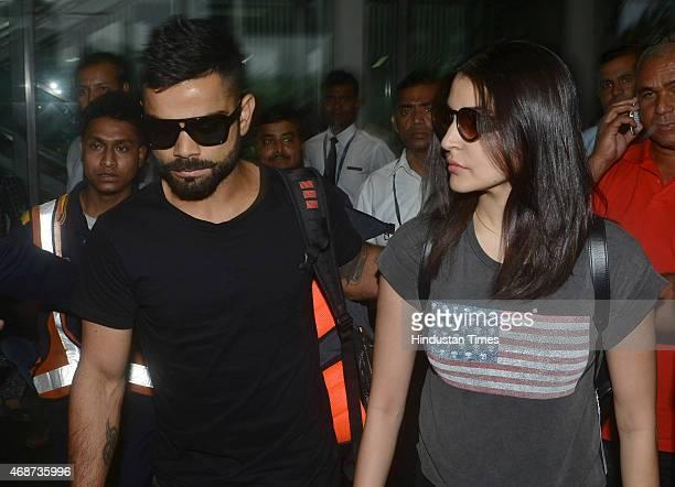 Bollywood actress Anushka Sharma and Indian cricketer Virat Kohli arrive at NSCBIA Dum Dum Airport on April 6 2015 in Kolkata India Bollywood actors...