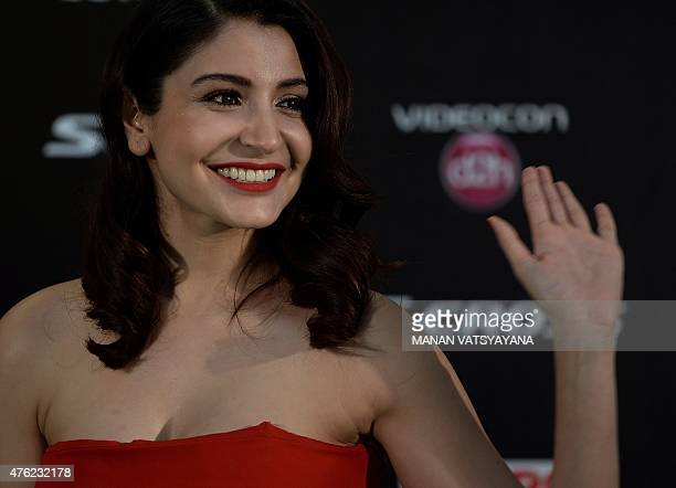 Bollywood actress Anushka Sharma poses on the green carpet as she arrives to attend the final day of the 16th International Indian Film Academy...