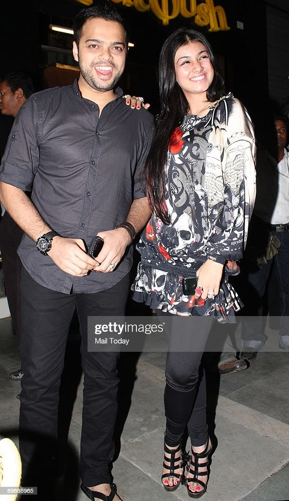 Bollywood actress Ayesha Takia poses with her husband Farhan at an event in Mumbai on Wednesday August 5 2009