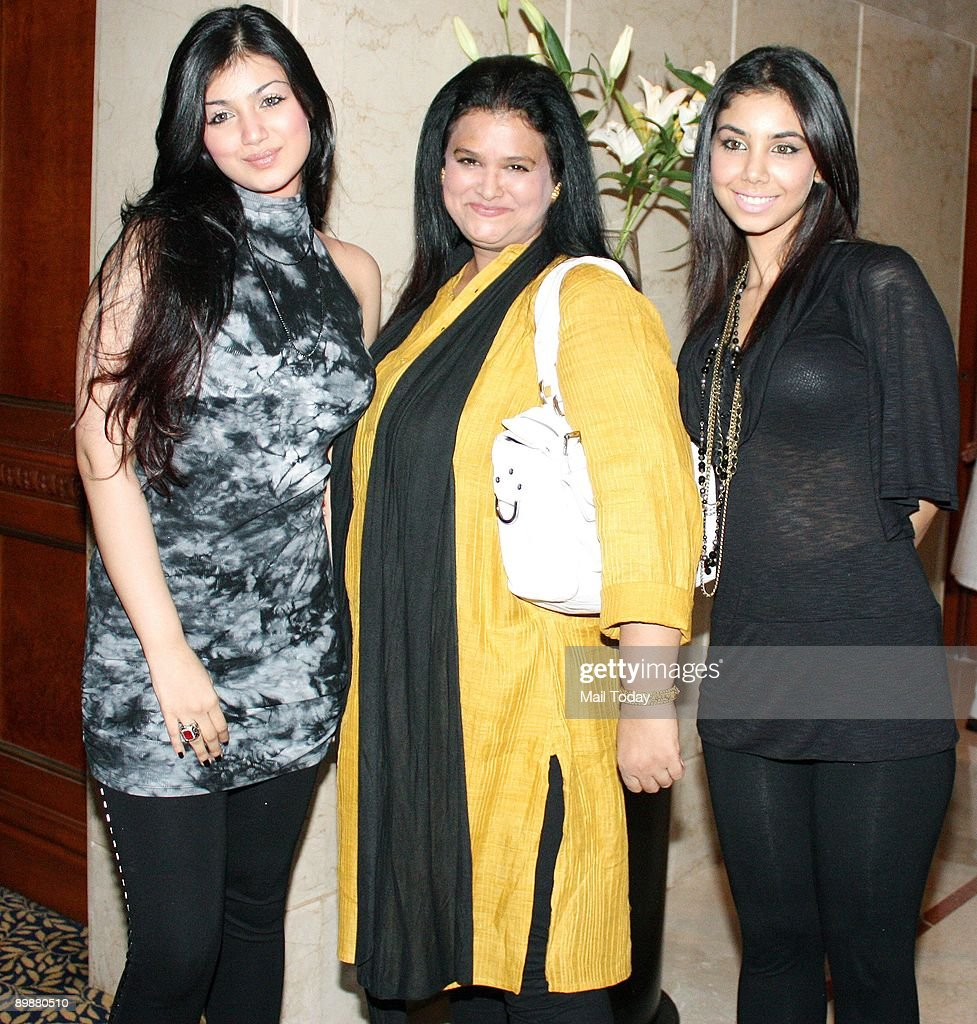Bollywood actress Ayesha Takia with her mother and sister at a press conference for her forthcoming film Wanted in Mumbai on Tuesday August 18 2009