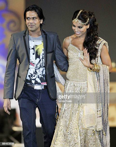 Bollywood actress Bipasha Basu and Indian designer Rocky S acknowledge the crowd during the Fashion Extravaganza event as part of the 2009...