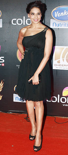 Bollywood actress Bipasha Basu poses during the inaugural of Super Fight League in Mumbai on March 11 2012 SFL is a mixed martial arts fighting...
