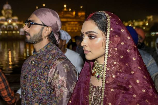 Bollywood actress Deepika Padukone along with her husband actor Ranveer Singh look on as they pay respect, to celebrate their one-year wedding...