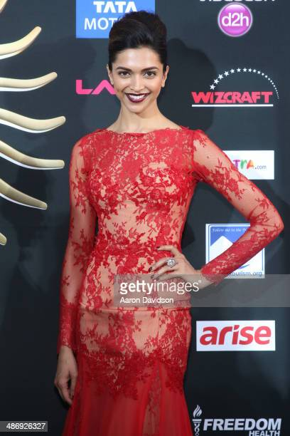 Bollywood actress Deepika Padukone arrives at the IIFA Awards at Raymond James Stadium on April 26 2014 in Tampa Florida