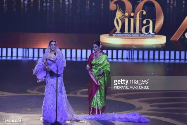 Bollywood actress Deepika Padukone reacts after receiving the Best Actress in Last 20 Years award from actress Rekha during the 20th International...