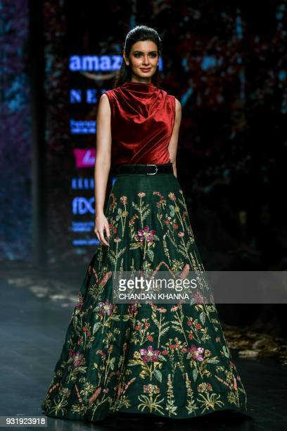 Bollywood actress Diana Penty presents a creation by Indian designer Shyamal and Bhumika Shodhan during the Amazon India Fashion Week Autumn Winter...