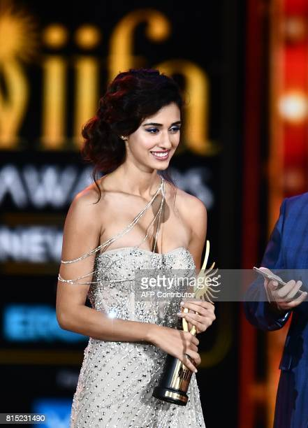 Bollywood actress Disha Patani accepts Best Debut actress award during the 18th International Indian Film Academy Festival at the MetLife Stadium in...