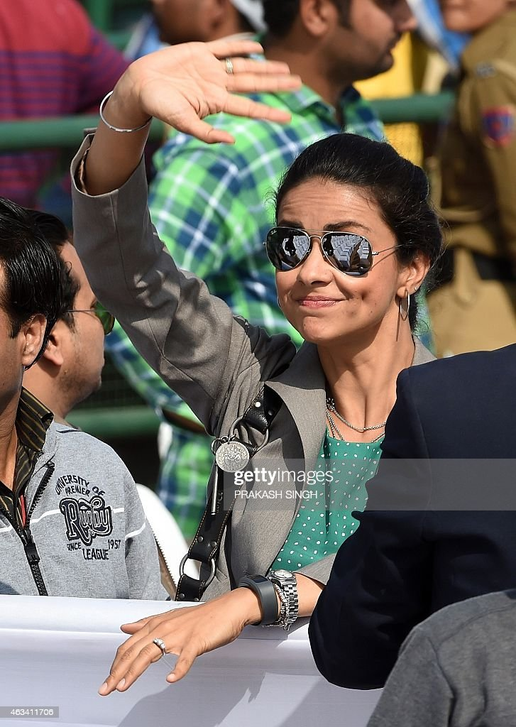 Bollywood Actress Gul Panag and Aam Aadmi Party (AAP) leader Gul Panag waves as AAP president Arvind Kejriwal is sworn in as Delhi chief minister in New Delhi on February 14, 2015. Arvind Kejriwal promised to make Delhi India's first corruption-free state and end what he called its 'VIP culture' as he was sworn in as chief minister before a huge crowd of cheering supporters .