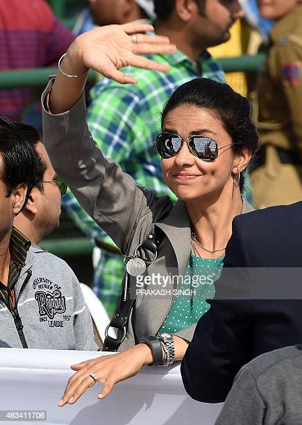 Bollywood Actress Gul Panag and Aam Aadmi Party leader Gul Panag waves as AAP president Arvind Kejriwal is sworn in as Delhi chief minister in New...