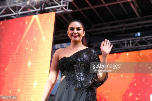 Bollywood actress Huma Qureshi waves at fans during IIFA Stomp in the Times Square on July 13 2017 to kick off the 18th International Indian Film...