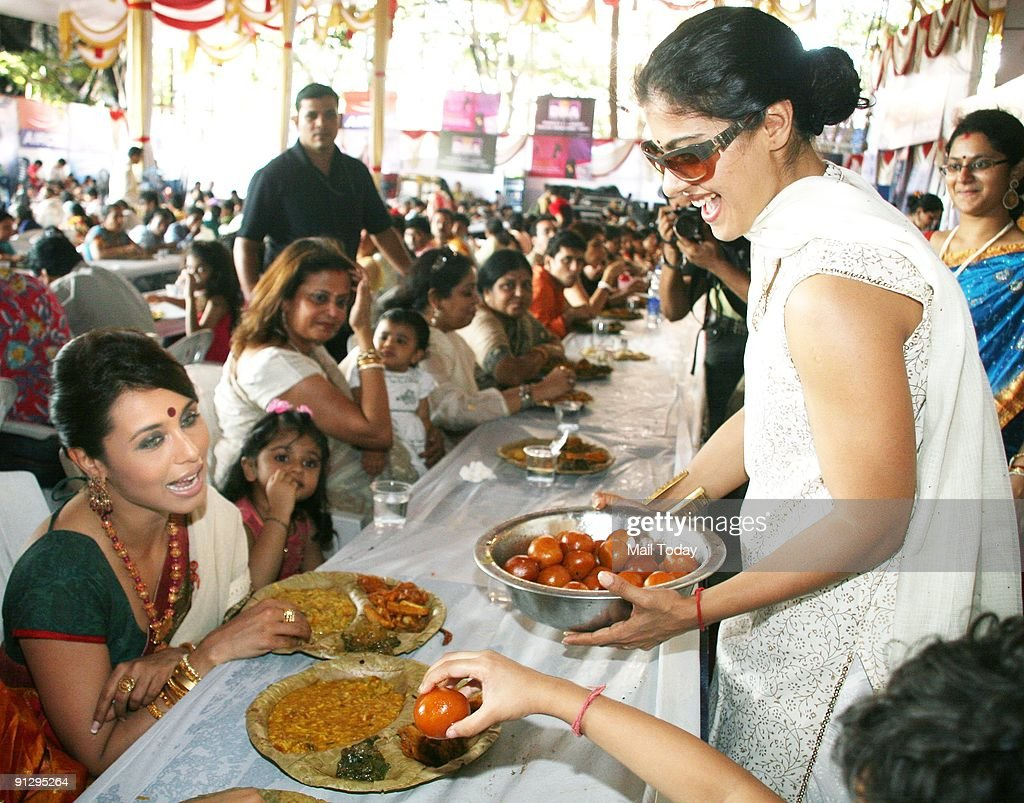 Bollywood actress Kajol serves food to Rani Mukherjee at a Durga Puja pandal in Mumbai on Saturday August 26 2009