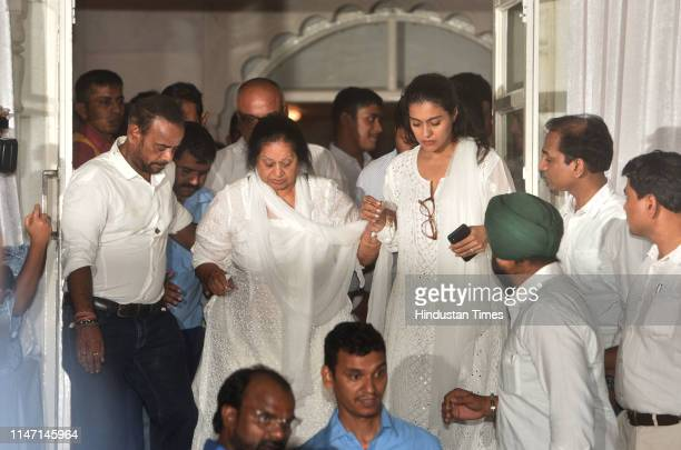 Bollywood actress Kajol with motherinlaw Veena Devgan at the prayer meet of her fatherinlaw and bollywood action director Veeru Devgan at ISKCON...