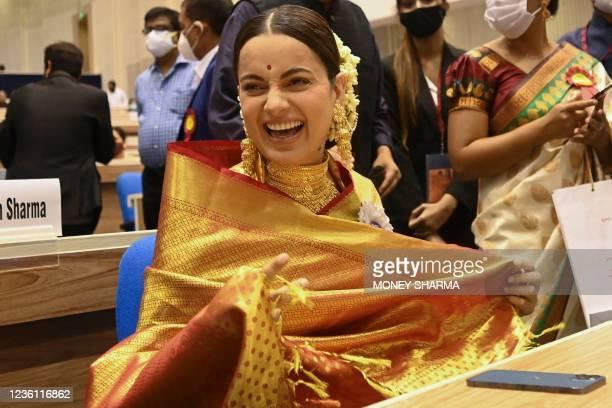 Bollywood actress Kangana Ranaut gestures as she attends the 67th National film awards and Dadasaheb Phalke Awards 2019 held in New Delhi on October...