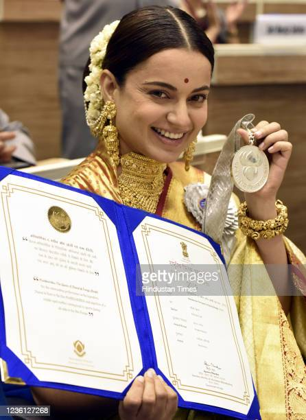 Bollywood actress Kangana Ranaut shows her medal at the 67th National Film Awards presentation ceremony after receiving by Vice president M. Venkaiah...