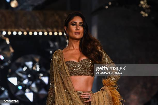Bollywood actress Kareena Kapoor Khan presents a creation by Indian designer Falguni Shane Peacock during the India Couture Week 2018 in New Delhi on...