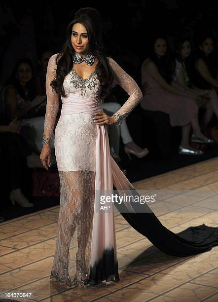 Bollywood actress Karishma Kapoor showcases a creation by designer Shehlaa during a fashion show on the second day of Lakme Fashion Week...