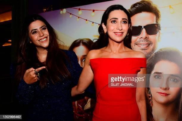 Bollywood actress Karisma Kapoor and producer Ekta Kapoor gesture during the trailer launch of the upcoming Hindi drama webseries 'Mentalhood' in...