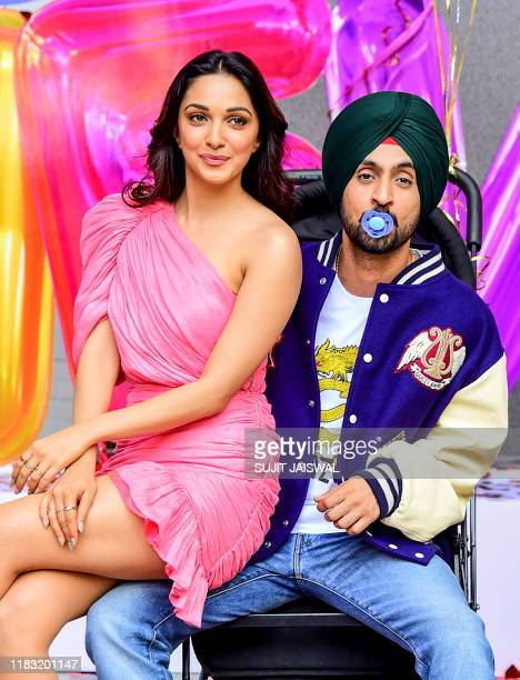 Bollywood actress Kiara Advani and actor Diljit Dosanjh pose for photographs during the trailer launch of their upcoming comedydrama Hindi film 'Good...