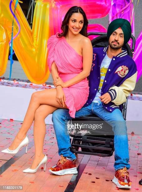 Bollywood actress Kiara Advani and actor Diljit Dosanjh pose for photographs during the trailer launch of their upcoming comedy-drama Hindi film...