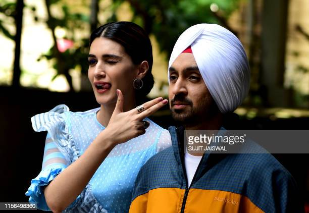 Bollywood actress Kriti Sanon and actor Diljit Dosanjh pose for photographs during the promotion of their upcoming romantic comedy Hindi film 'Arjun...