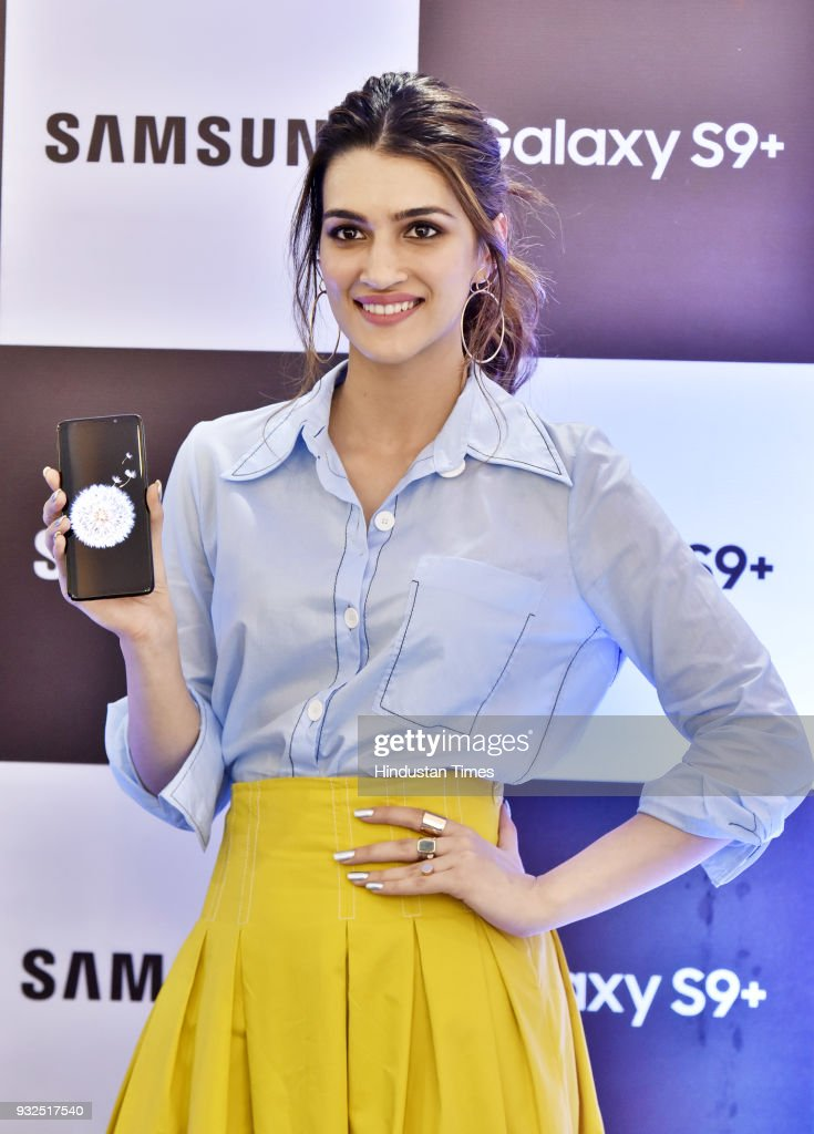 Bollywood actress Kriti Sanon poses with Samsung Galaxy S9 phone during the costumer launch day for Samsung Galaxy S9/S9 at Cyber Hub on March 15...