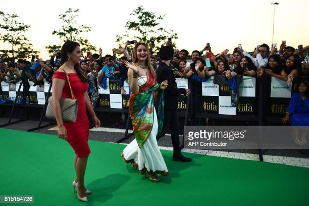 Bollywood actress Lara Dutta actress Sonakshi Sinha and actor/singer Diljit Dosanjh arrive for the IIFA Awards of the 18th International Indian Film...