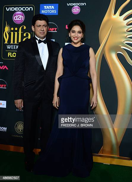 Bollywood actress Madhuri Dixit and her husband Sriram Madhav Nene pose on the green carpet at the Raymond James Stadium on the fourth and final day...