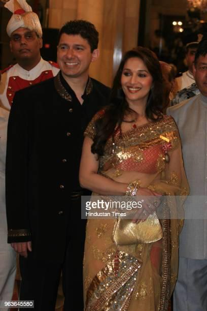 Bollywood actress Madhuri Dixit Nene and her husband Dr Shriram Nene during the Padma award function at the Rashtrapati Bhawan on May 10 2008 in New...