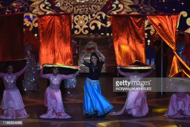 Bollywood actress Madhuri Dixit performs on stage during the 20th International Indian Film Academy Awards at NSCI Dome in Mumbai on September 18 2019