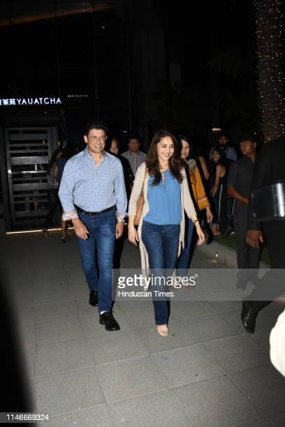 Bollywood actress Madhuri Dixit with husband Sriram nene seen spending quality time at BandraKurla Complex on May 24 2019 in Mumbai India