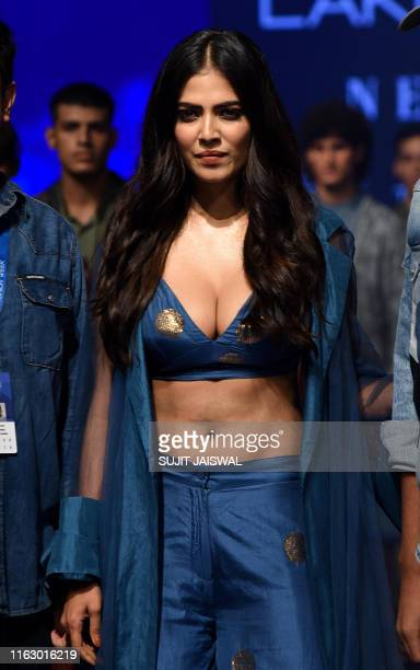 Bollywood actress Malavika Mohanan presents a creation by designer Vineet Trahul during a fashion show at Lakme Fashion Week Winter Festive 2019 in...