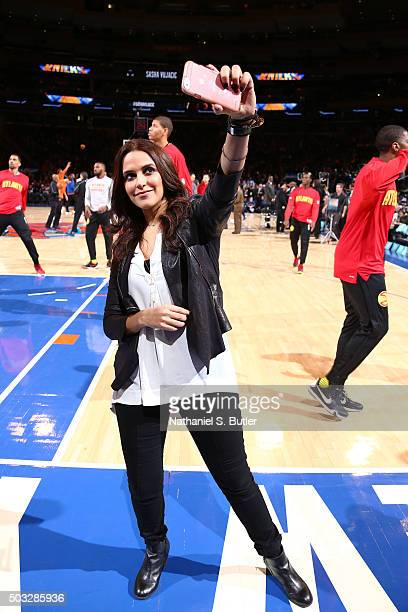 Bollywood actress Neha Dhupia before the New York Knicks face off against the Atlanta Hawks on January 3, 2016 at Madison Square Garden in New York,...