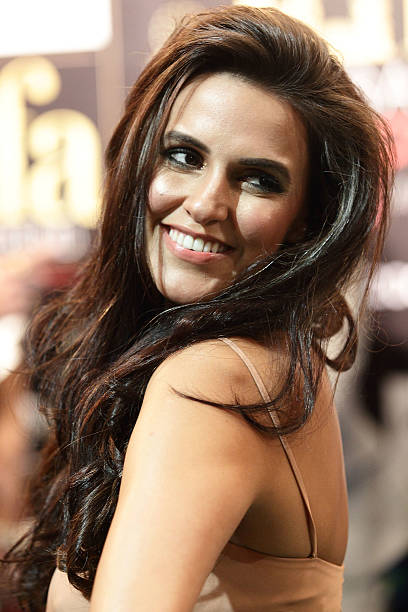 Bollywood actress Neha Dhupia poses on the green carpet during the IIFA Rocks Green Carpet on day two of the 2012 International India Film Academy...