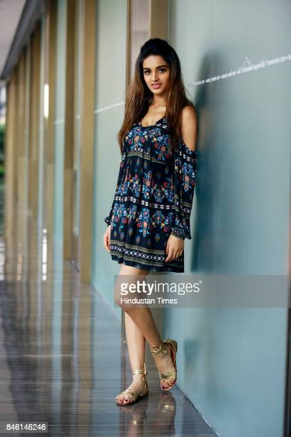 Bollywood actress Nidhhi Agerwal poses for photograph during promotion of her film Munna Michael at Roseate House Hotel on July 18 2017 in New Delhi...