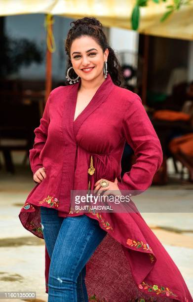 Bollywood actress Nithya Menen poses during the promotion of her upcoming drama Hindi film 'Mission Mangal' in Mumbai on August 7 2019
