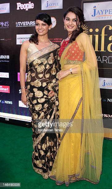Bollywood actress Pooja Kumar and Andrea Jeremiah posing for the camera on Green carpet of International India Film Academy Awards presentation...