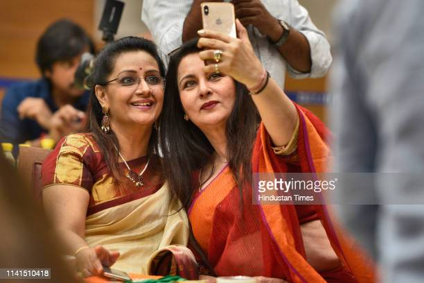 Bollywood actress Poonam Dhillon takes selfie during an event 'Celebrities with NaMo' organised by Bharatiya Janta Party in support of Prime Minister...